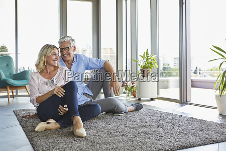 smiling mature couple relaxing at home