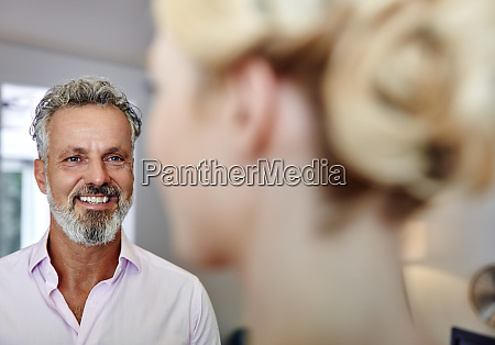 smiling mature man looking at female