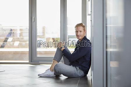portrait of smiling businessman sitting at