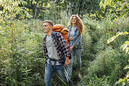 young couple hiking together in nature