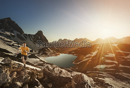 germany allgaeu alps man running in