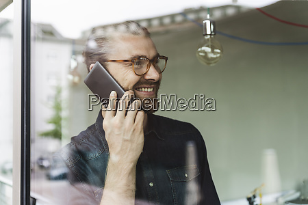 smiling young businessman on cell phone