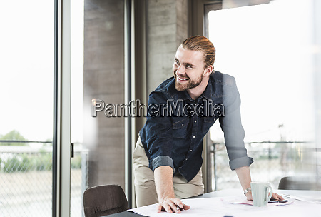 smiling young businessman working on plan