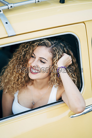 smiling young woman looking out of
