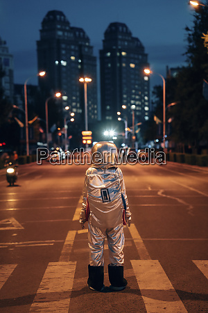 rear view of spaceman standing on