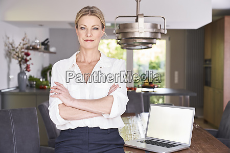 portrait of confident businesswoman at home