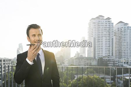 business man in dark suit speaking
