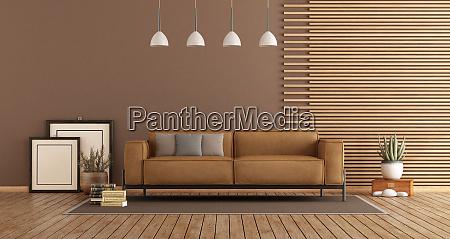 modernes wohnzimmer mit sofa und holzverkleidung