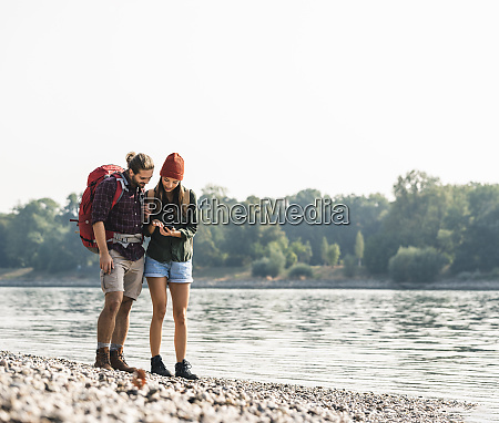 young couple with backpacks at the