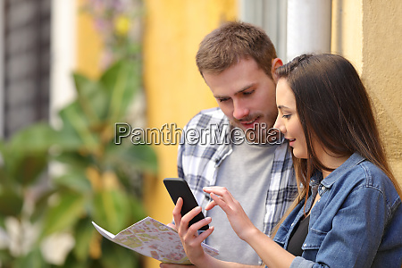 serious tourists checking phone on vacation