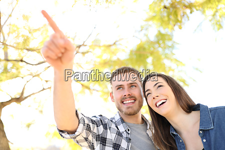 happy couple pointing location in a
