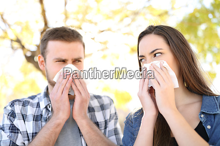 ill couple suffering contagious flu outdoors