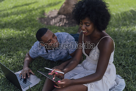 happy young couple using tablet and