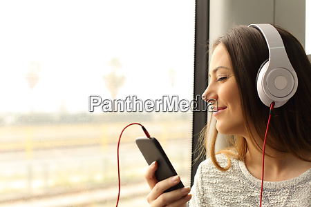 commuter traveling into a train listening