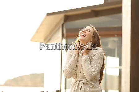 cheerful hotel guest breathing fresh air