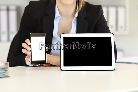 businesswoman showing blank tablet and phone