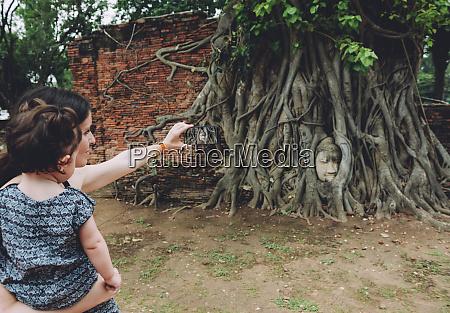 thailand ayutthaya mother and daughter taking