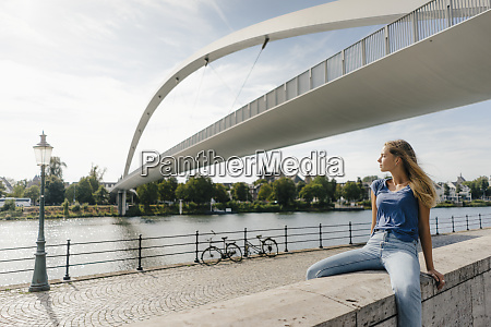 netherlands maastricht young woman sitting on