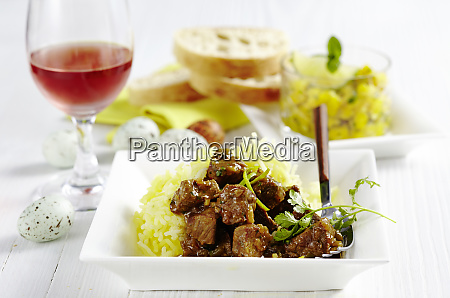 lamb curry on potato straw served