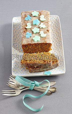 a carrot loaf cake decorated with