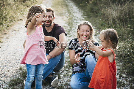 happy family with two daughters playing