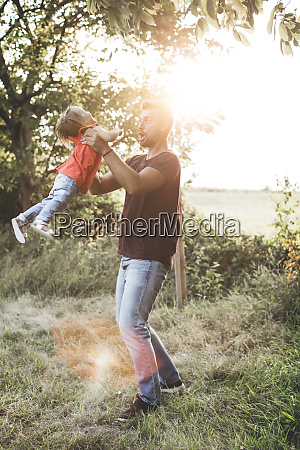 happy father playing with daughter on