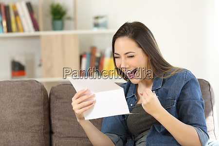 excited woman reading great news in