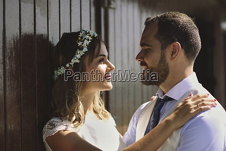 bridal couple enjoying romantic moments in