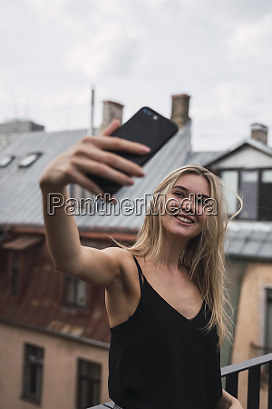 portrait of smiling blond woman taking