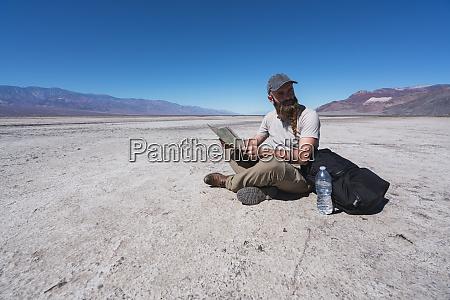 usa california death valley man sitting