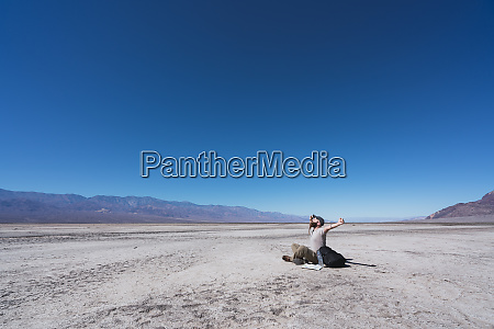 usa california death valley man sitting