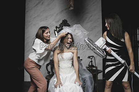 playful friends and bride during wedding