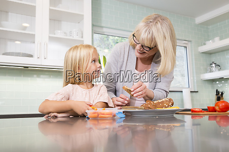 grandmother and granddaughter preparing lunch box