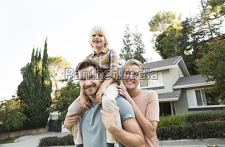 portrait of smiling parents with son