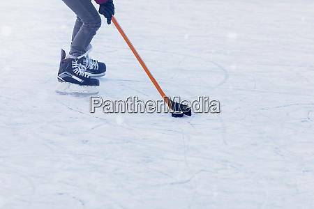 person playing ice hockey on frozen