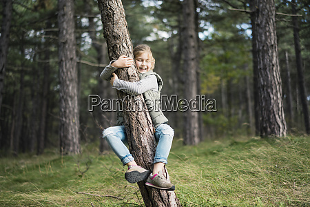girl hugging a tree in the