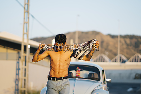 man walking shirtless in front of