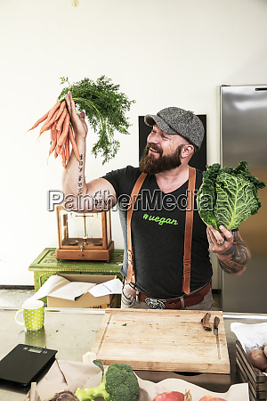 vegan man choosing vegetables in his