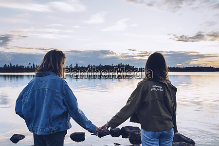 girl friends looking at lake inari
