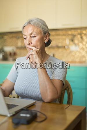 portrait of senior woman using laptop