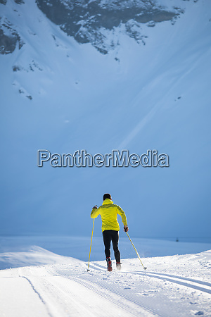 cross country skiing young man cross