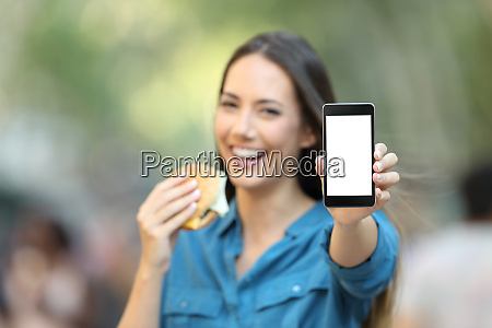 woman holding a burger showing a