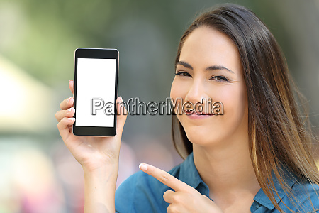 satisfied woman pointing at a blank