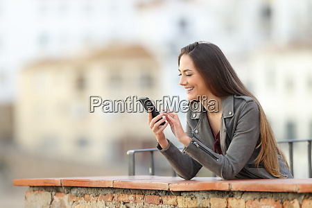 happy girl using a smart phone