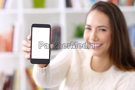 woman wearing sweater showing smart phone