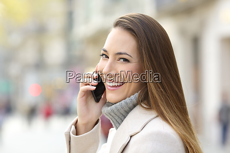 happy girl calling on phone in