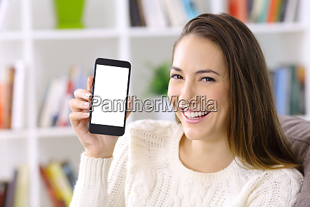 happy woman showing smart phone screen