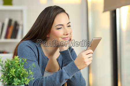 relaxed girl checking a smart phone