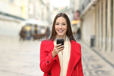 happy woman looking at camera holding