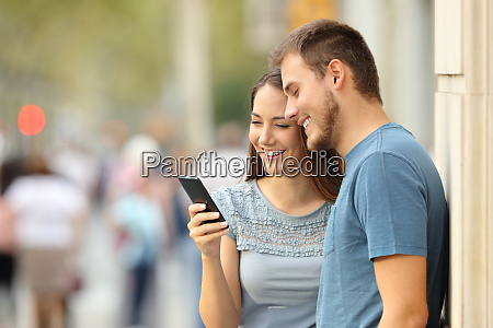 couple watching on line media in